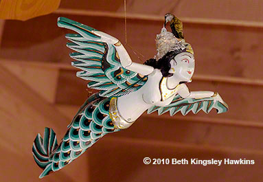 Black-chinned hummingbird nest on a 'flying mermaid' sculpture, which I called the Dragonlady